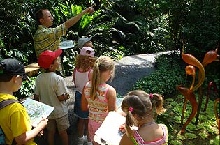 Instructor leading students through Climatron