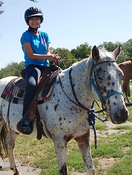 ECO-ACT participant on horseback