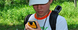 Boy looking at GPS unit