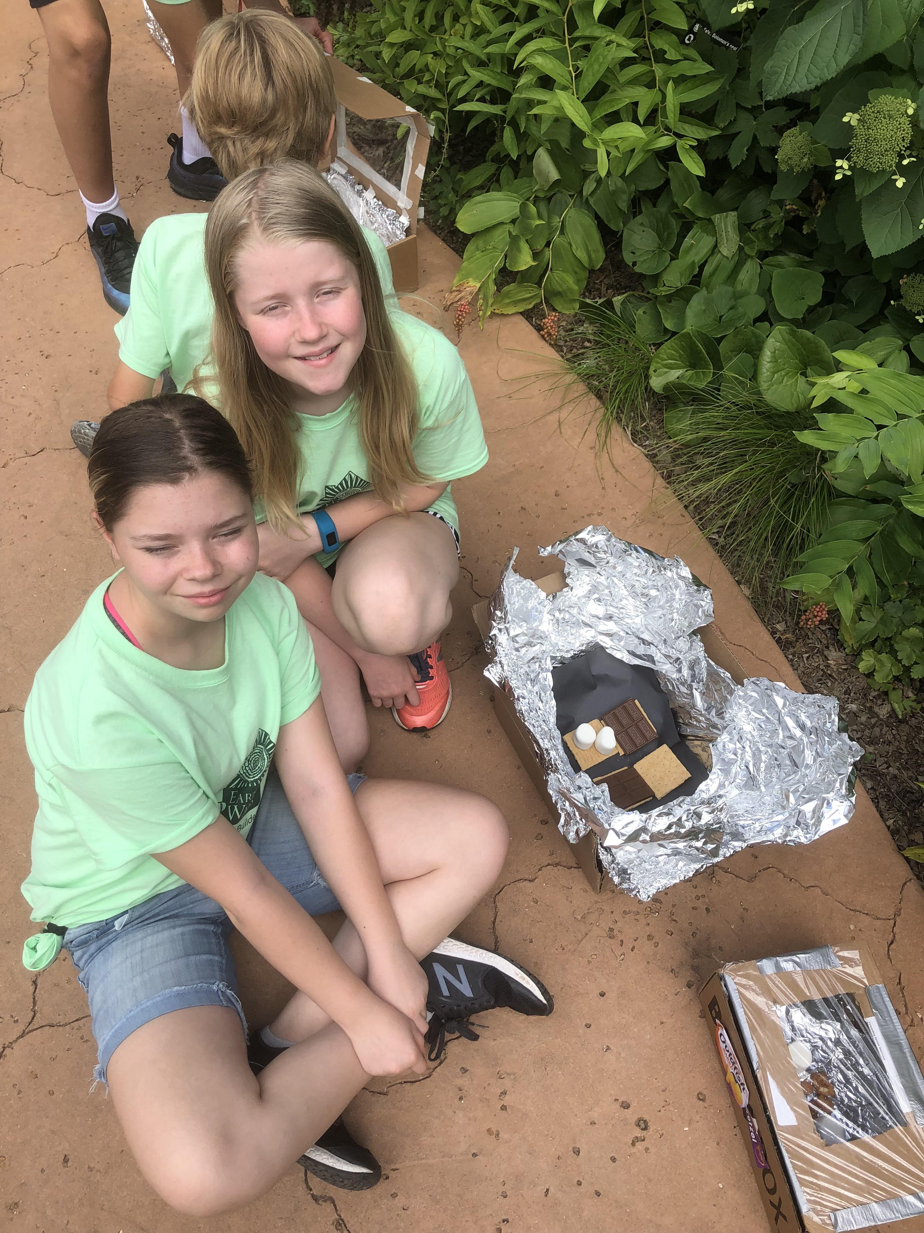 Campers with solar ovens
