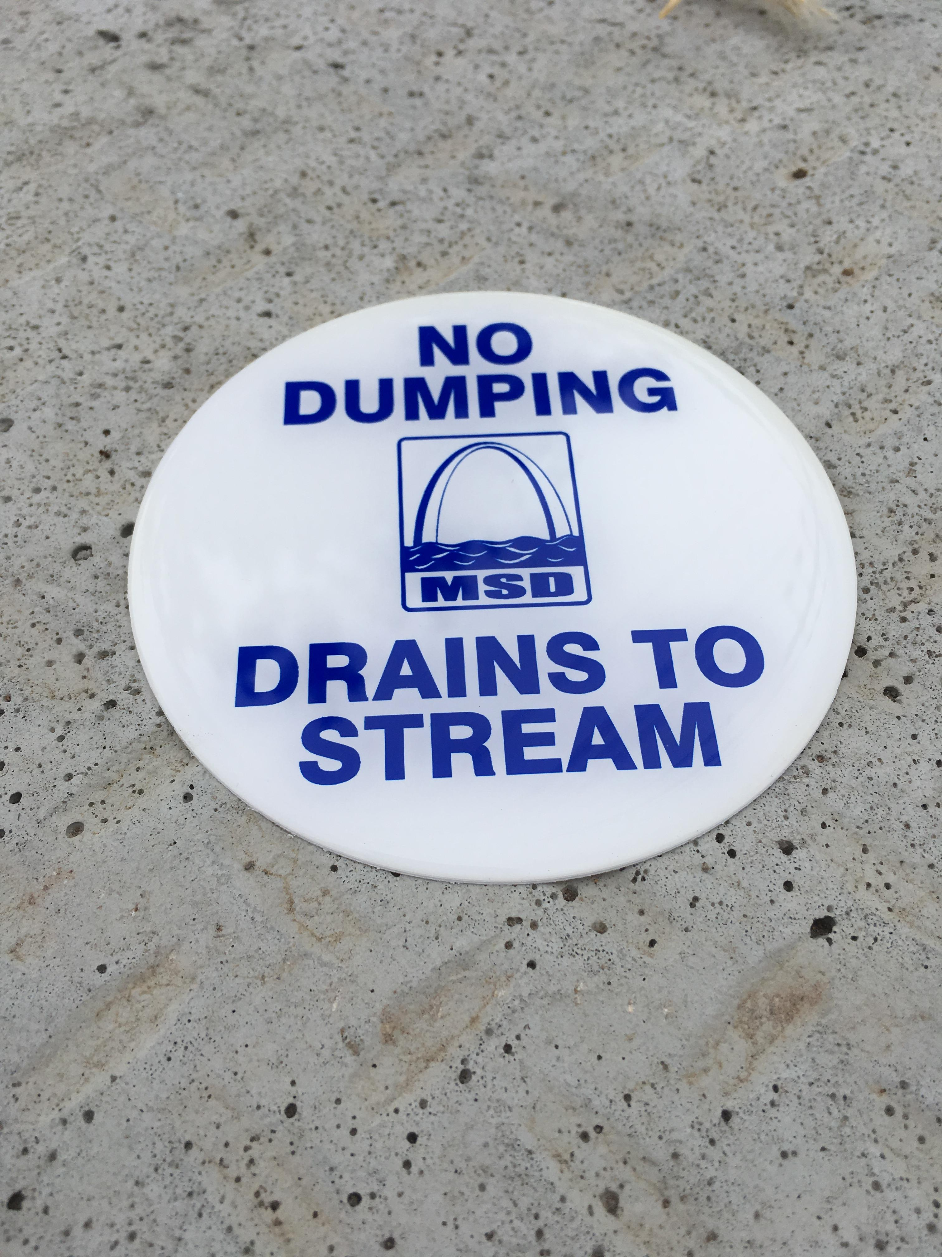 No Dumping--Drains to Stream sign